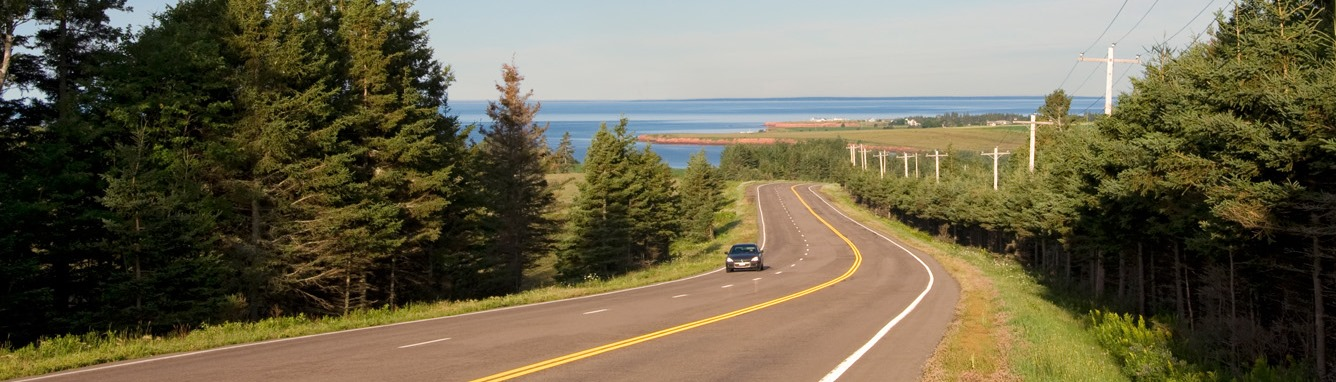 Vehicle driving on Route #1 in Desable, PEI